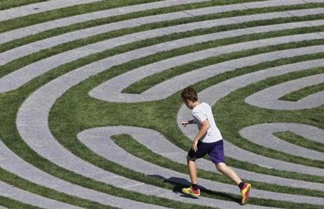 A boy ran along a maze-like installation on the Greenway.